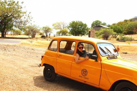 Petite, yellow taxi taking us to the seaside
