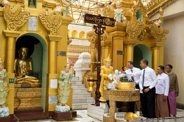 Barack Obama pours water over the Buddha statue at the Friday planetary post